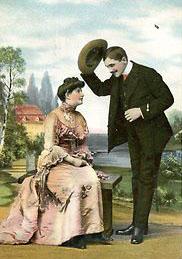Man lyfter på hatten för kvinna